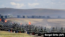 "RUSSIA -- Chinese tanks roll during a military exercises on training ground ""Tsugol"", about 250 kilometers (156 miles ) south-east of the city of Chita during the military exercises Vostok 2018 in Eastern Siberia, September 13, 2018. File photo"