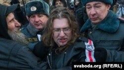 Maksim Vinyarski is detained in Moscow in December 2012.