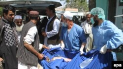 A man injured in the accident is brought to a local hospital in Ghazni.