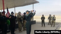 FILE: A police graduation ceremony in Tarinkot, Afghanistan.