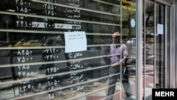The decision comes amid a plunging national currency that has lost about half of its value in past weeks following a decision in May by U.S. President Donald Trump to leave the 2015 nuclear deal with Iran and reimpose tough sanctions.