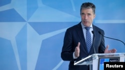 "NATO chief Anders Fogh Rasmussen described the new deployments as being about ""defense, deterrence, and de-escalation,"" and said they were ""entirely in line"" with NATO's international commitments governing the activities of military forces."