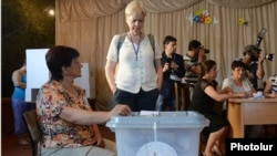 A foreign observer monitors voting at a polling station in Stepanakert, Nagorno-Karabakh, on July 19.