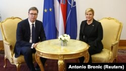 Croatian President Kolinda Grabar-Kitarovic (right) and Serbian President Aleksandar Vucic in Zagreb on February 12