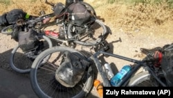 The seven had met while cycling in the region and decided to ride together through a lower route in the picturesque Pamir Mountains.
