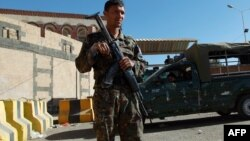 A Yemeni soldier stands guard outside the UU embassy in the capital Sanaa.