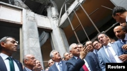 Turkey's Prime Minister Binali Yildrim (C) visits damaged parts of the Turkish parliament in Ankara, Turkey on July 19.