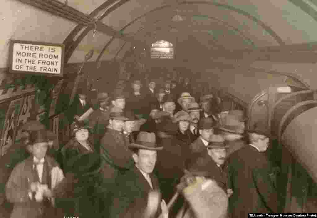 A crowded platform at Piccadilly Circus Station, undated