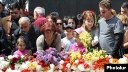Armenians lay flowers at the Armenian Genocide Memorial in Yerevan on April 24.