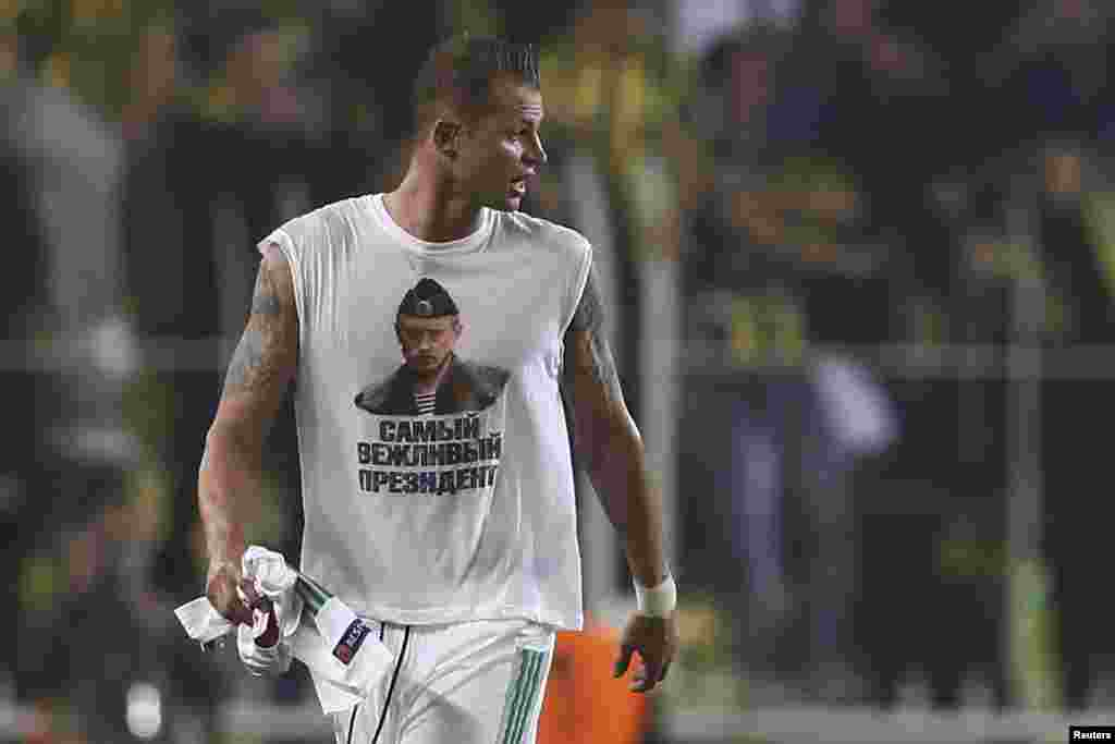 "Lokomotiv Moscow's Dmitri Tarasov wears a T-shirt depicting Russian President Vladimir Putin and the slogan, ""Most Polite President."" Lokomotiv may face disciplinary action from European soccer's ruling body, as political statements are not allowed at competitions. Ties between Turkey and Russia have been tense since November when Turkey shot down a Russian warplane near its border with Syria. Fenerbahce won the match 2-0. (Reuters/Murad Sezer)"