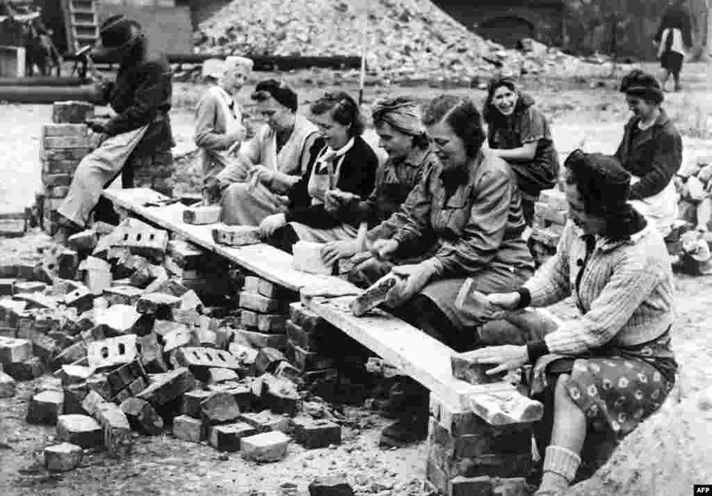 "Women salvaging bricks from the rubble of their city for reuse.   Many Russians were struck by the orderliness with which many Germans attempted to return to normality. Vasily Grossman described ""the ruins being tidied and swept…as if they were indoor rooms."""