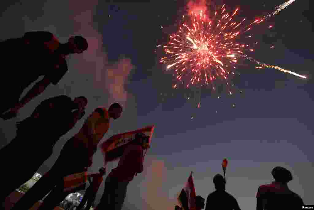 People celebrate in Baghdad after the United Nations announced the end of sanctions imposed on Iraq. (Reuters/Thaier al-Sudani )