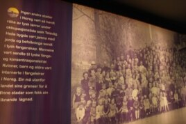 Музейный стенд. Старики, женщины и дети из Телевога. Фотография сделана после освобождения в 1944 году