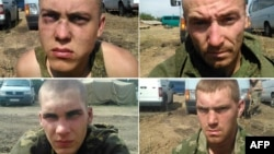 Handout pictures released by the Ukrainian Security Service (SBU) press service on August 26 purportedly show Russian paratroopers captured by Ukrainian forces near the village of Dzerkalne, in the Donetsk region.