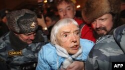 Russian riot police arrest Lyudmila Alekseyeva at a Moscow rally on December 31.