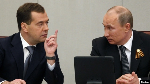 Could a generation gap be emerging in the Kremlin with a disconnect between older cronies of President Vladimir Putin (right) and younger individuals linked with Prime Minister Dmitry Medvedev?