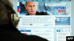 A Russian looks at Prime Minister Vladimir Putin's election campaign website.