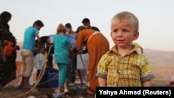 Сирийские беженцы в лагере для беженцев в Ираке. 28 августа 2013 года.