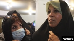 Faezeh Hashemi (right) attends a protest at a mosque in northern Tehran in 2009.