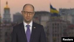A screen shot of Ukrainian Prime Minister Arseniy Yatsenyuk announcing his resignation on national television.
