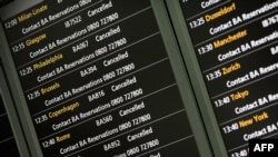 An electronic board shows flight cancellations at Heathrow Airport's Terminal 5 in London on April 15.