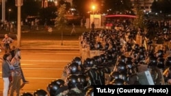 Protesters poured into the streets after the balloting ended, many of them facing off against riot police.