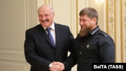 Belarusian President Alyaksandr Lukashenka (left) shakes hands with Ramzan Kadyrov, the leader of Russia's Chechen region in Minsk on September 25.