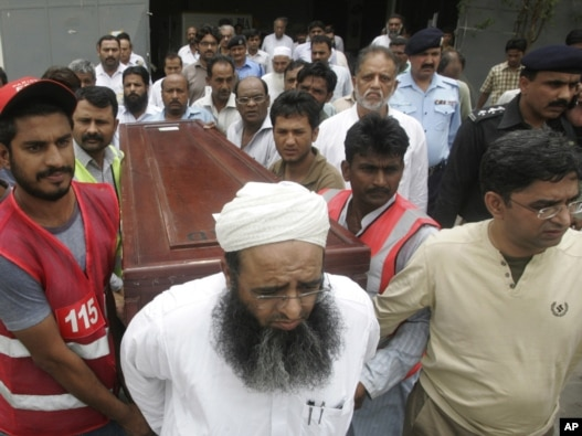 Mourners carry the coffin of journalist Syed Saleem Shahzad, who was killed in Pakistan this week. The country was listed by the Committee to Protect Journalists as one of the worst offenders in its 2011 Impunity Index