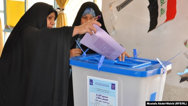 An Iraqi woman casts her ballot in Karbala on April 20.