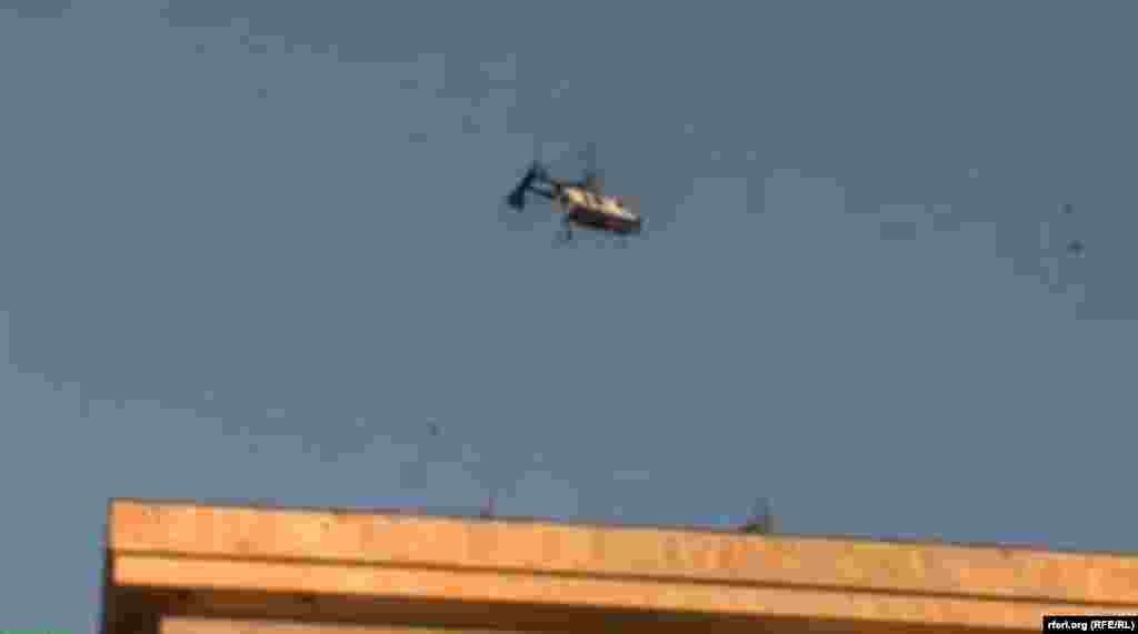 A police helicopter loomed over the crowd all afternoon and police were also seen photographing demonstrators.
