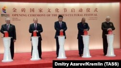 Brazil President Michel Temer (left to right), Russian President Vladimir Putin, Chinese President Xi Jinping, South African President Jacob Zuma, and Indian Prime Minister Narendra Modi attend the opening ceremony of the BRICS cultural festival in Xiamen on September 4.