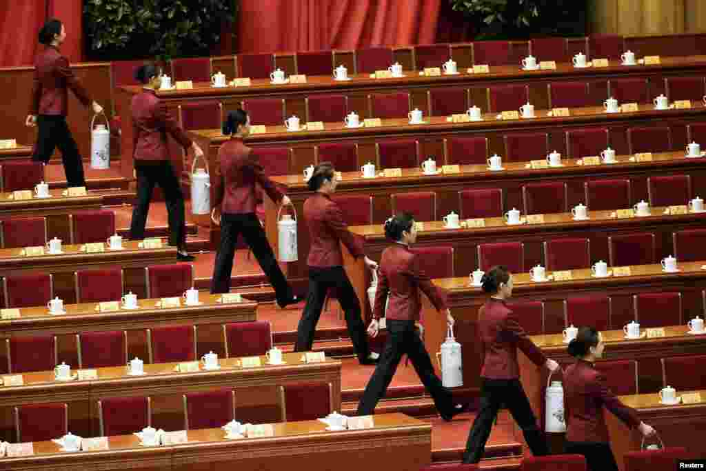 Attendants carry tea for delegates ahead of the opening session of the Chinese People's Political Consultative Conference in the Great Hall of the People in Beijing. (Reuters/Jason Lee)