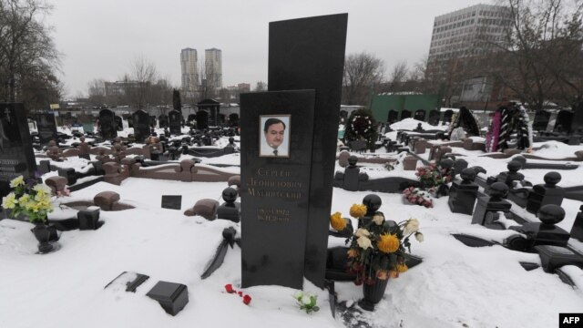Snow covers the grave of lawyer Sergei Magnitsky with his portrait on the tomb at the Preobrazhenskoye cemetery in Moscow in December.