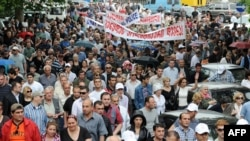 Opposition supporters block traffic in Tbilisi on May 21.