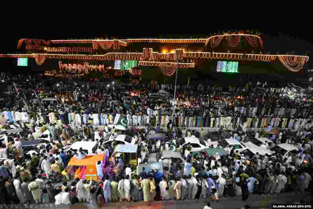 Dense crowds celebrate Independence Day in Peshawar early on August 14.