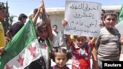 Syria -- Young demonstrators protest against Syria's President Bashar al-Assad in Al Kasten, near Idlib, 29Jun2012