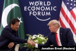 U.S. President Donald Trump shakes hands with Pakistani Prime Minister Imran Khan during a bilateral meeting at the 50th World Economic Forum annual meeting in Davos, in January. (file photo)