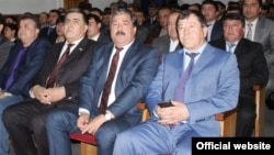 Interior Minister Ramazon Rahimzoda (right) is apparently no stranger to writing.