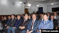 Tajik police attending the theater in Dushanbe on April 11 as ordered by their bosses.
