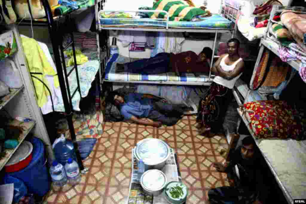 In the neighborhood of Deira, some 20 Pakistani workers share a 22-square-meter room, for which they each pay $55 a month.
