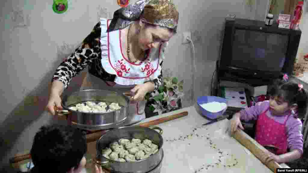 Making traditional food while the kids watch
