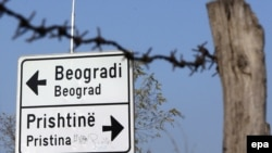 Kosovo -- A traffic sign at the entrance of the ethnically divided town of Mitrovica.