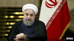 Iran-- Iranian President Hassan Rouhani said on Sunday that, if its interests were protected, Tehran would remain committed to its 2015 nuclear deal, May 13, 2018.