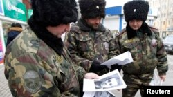 В проверках на дорогах и на транспорте в Волгоградской области участвуют казаки. 2 января 2014 г.