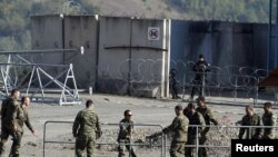 Kosovo Force (KFOR) soldiers from Armenia and Germany put up barricades at the closed Serbia-Kosovo border crossing of Jarinje on September 28.