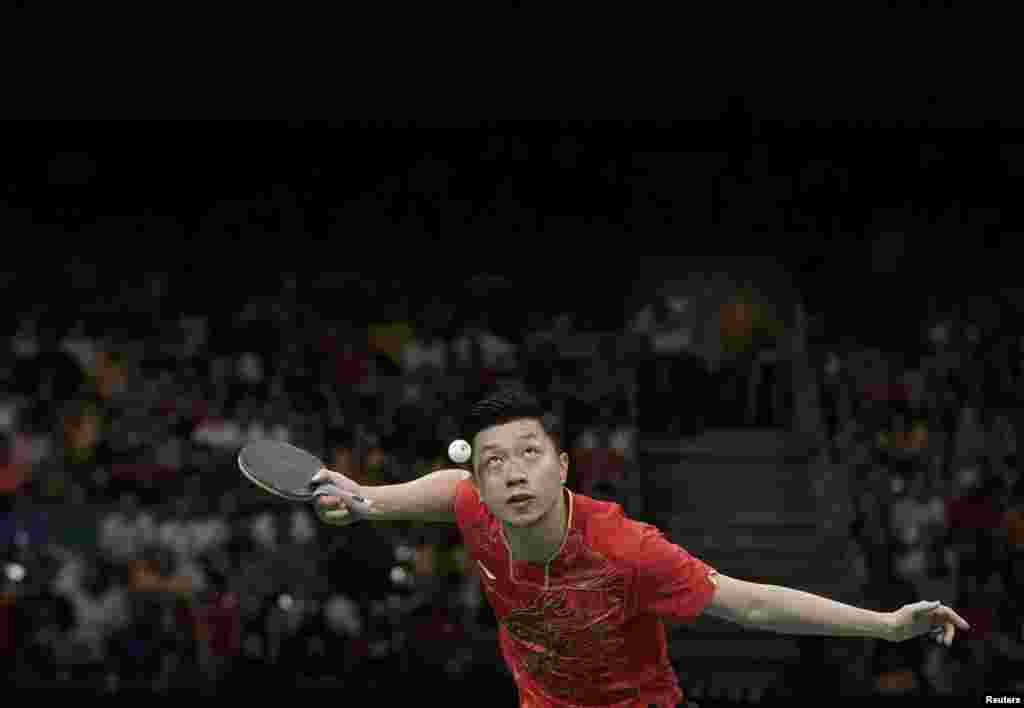 China continued to dominate the Olympic diving events, while it swept the table-tennis tournament, taking home every gold medal for the third Olympics in a row. Ma Long of China plays against Koki Niwa of Japan in the gold-medal match.