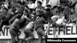 UK- Liverpool fans trying to escape severe overcrowding during the severe crushing at Hillsborough stadium in Sheffield England during an FA Cup semi-final football match between Liverpool and Nottingham Forest. 1989