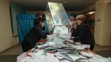 Kazakhstan -- Members of a local election committee empty a ballot box to count votes after a snap parliamentary election in Kyzylorda, March 20, 2016