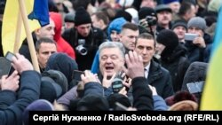 Poroshenko meets with people rallying outside St. Sophia's before the council met on December 15.