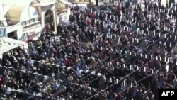 An image grab taken from a video uploaded on YouTube purporting to show antiregime protesters in Idlib on November 11.